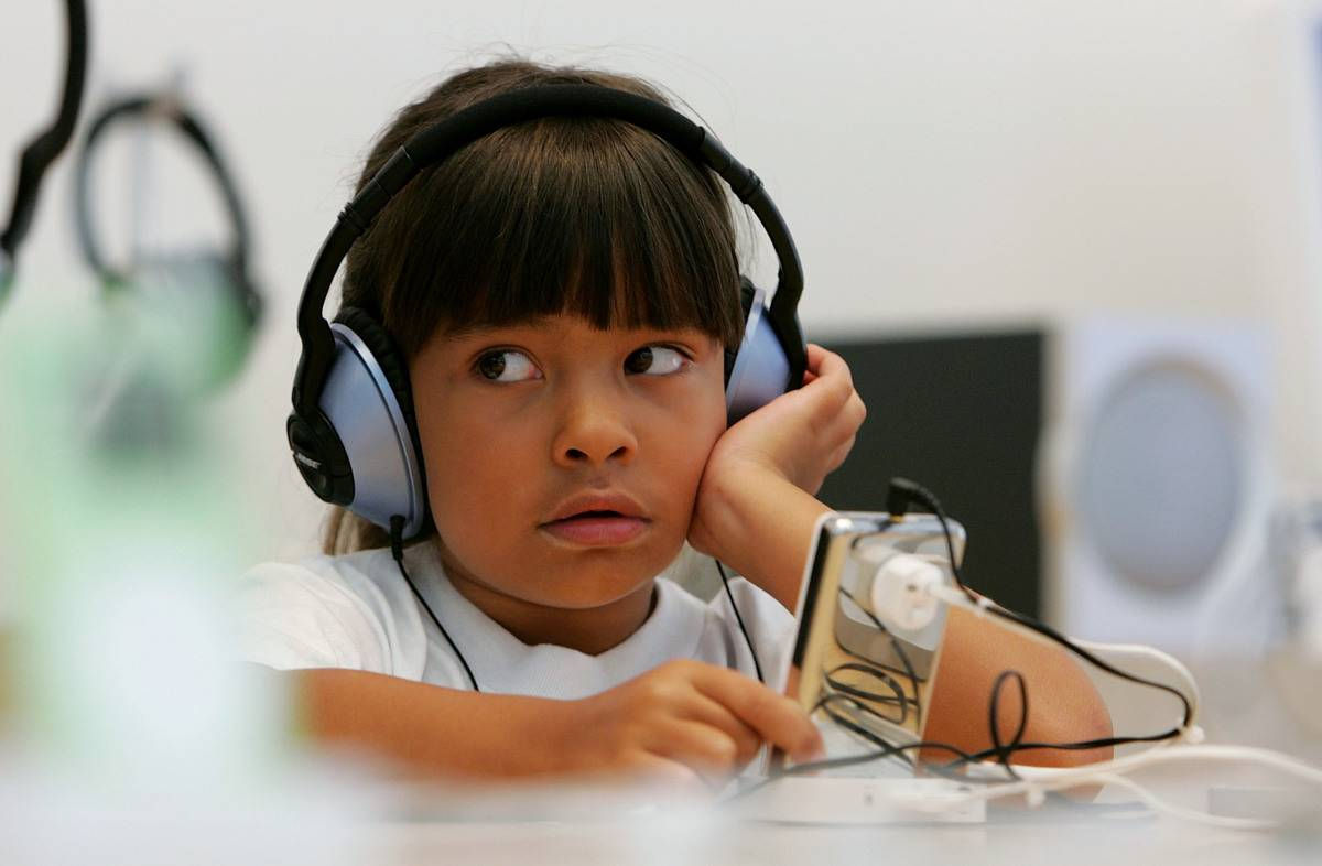 six-year-old child with headphones on