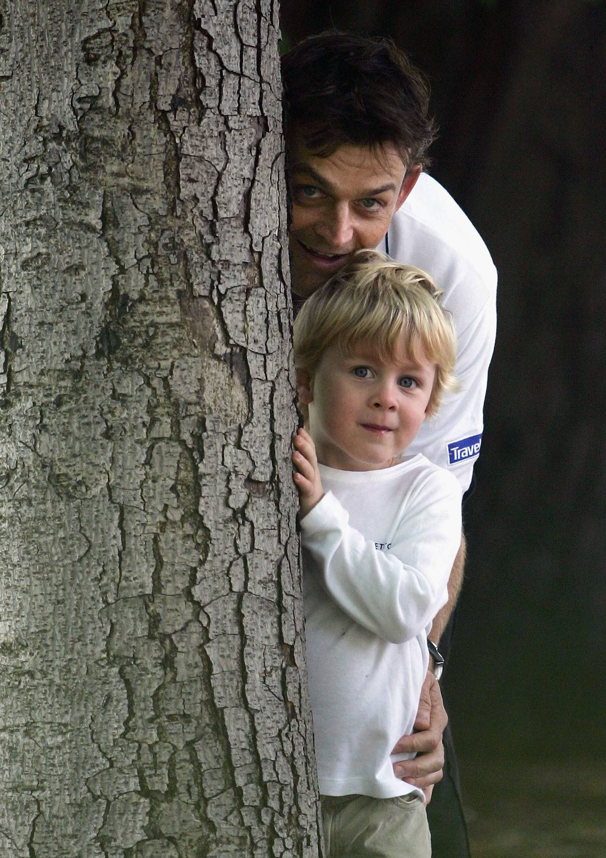 Adam Gilchrist of Australia hides with his son Harry