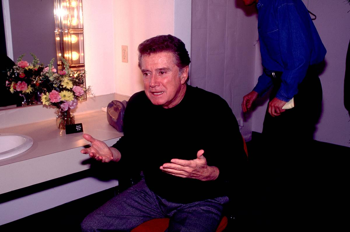 Regis Philbin sits backstage.