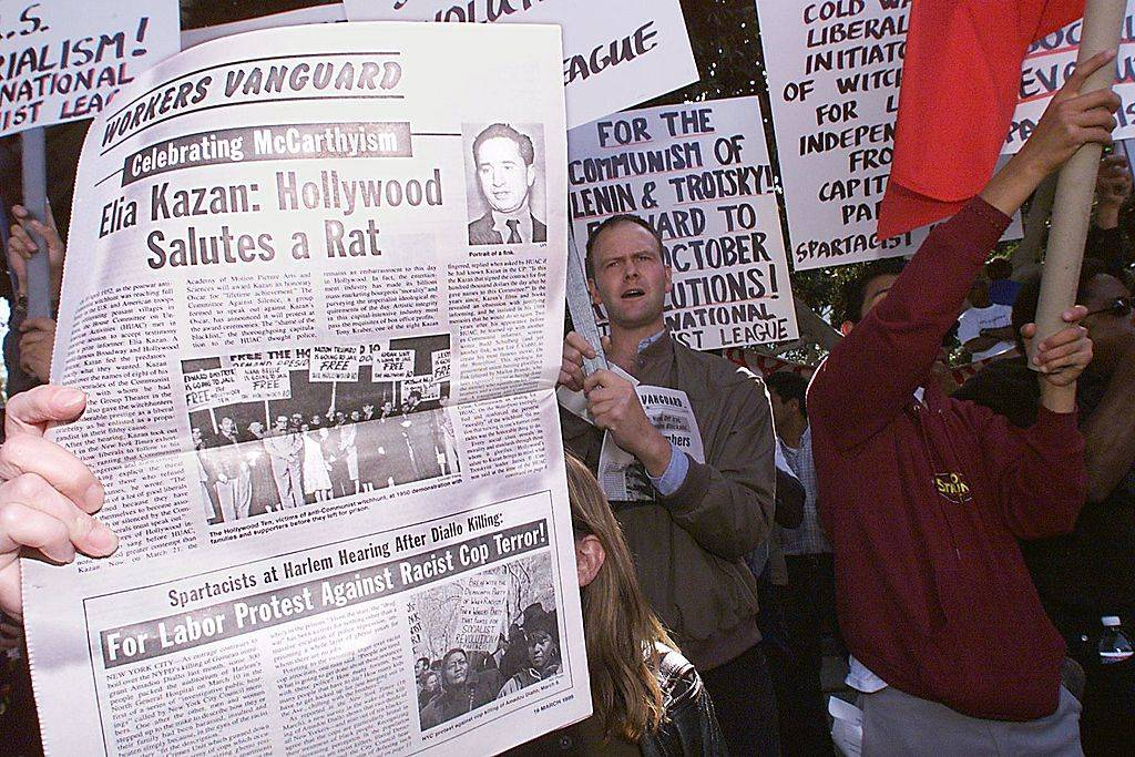This file photo dated 21 March 1999 shows protestors demonstrating against the Lifetime Achievement Award to be presented to US film director Elia Kazan