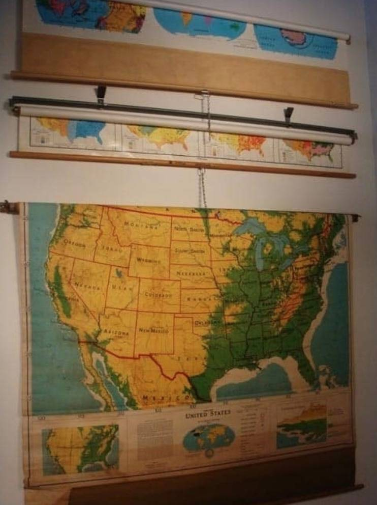 map pulled down on wall with draw string
