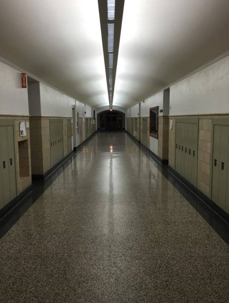 dimly lit classroom hallway
