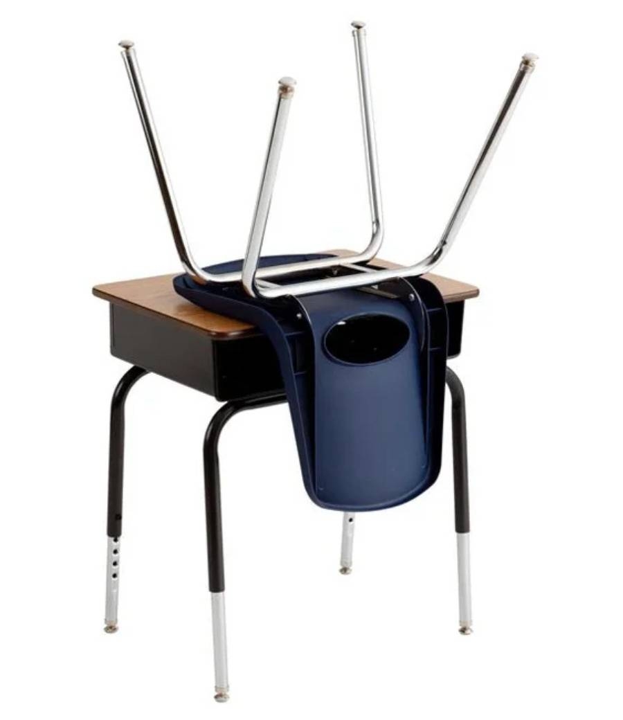 chair flipped upside down resting on desk