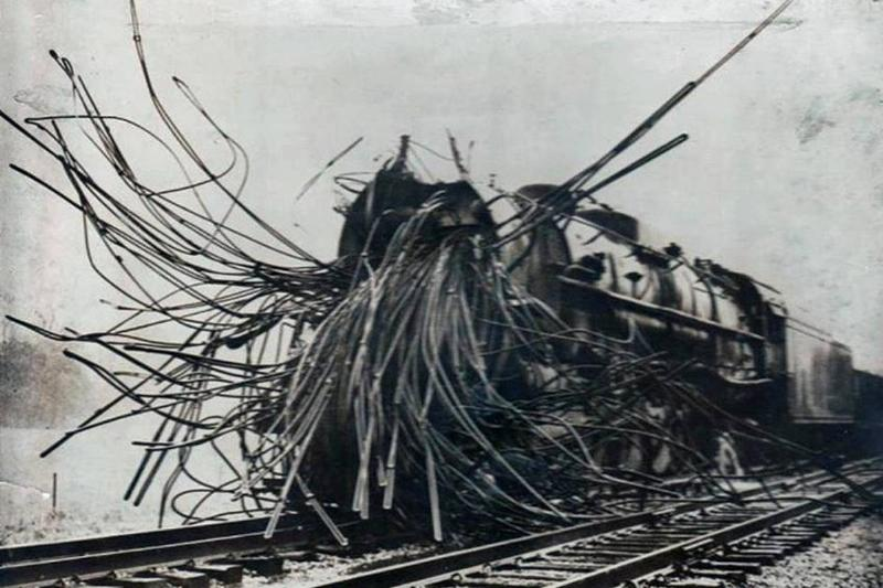 The aftermath of a boiler explosion is photographed.