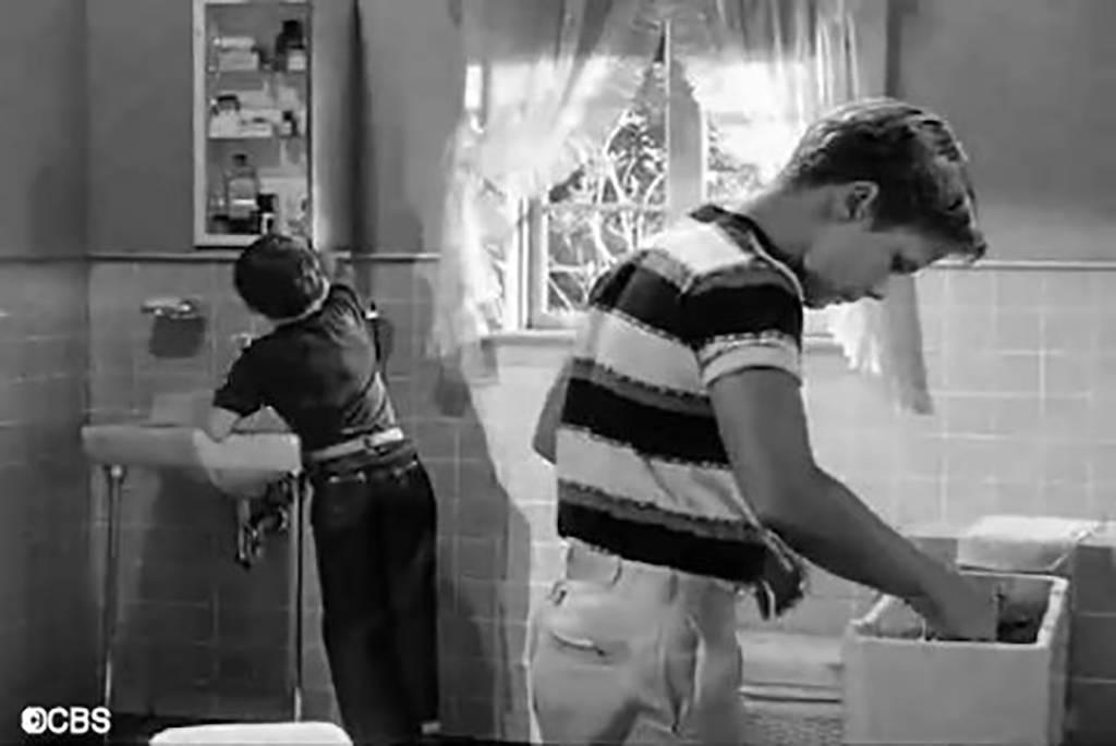 Boy working on toilet