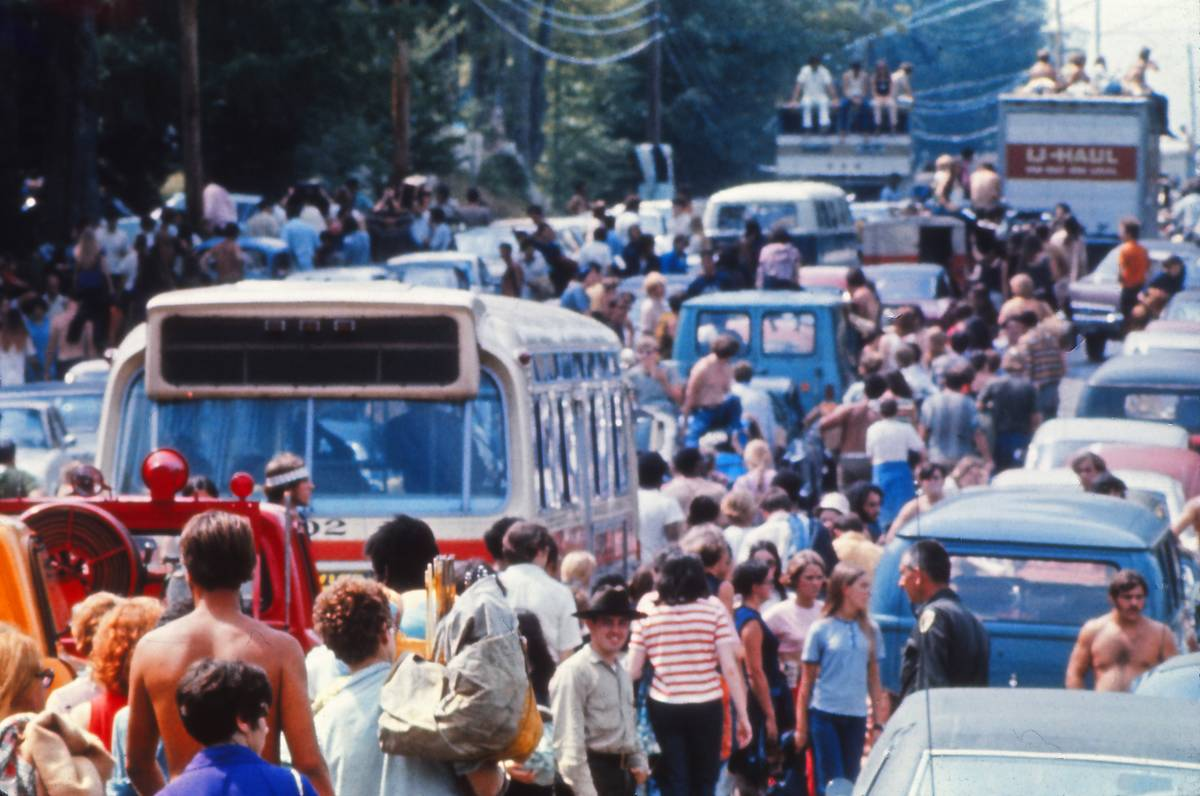 People Making Their Way To Woodstock In The Summer Of '69