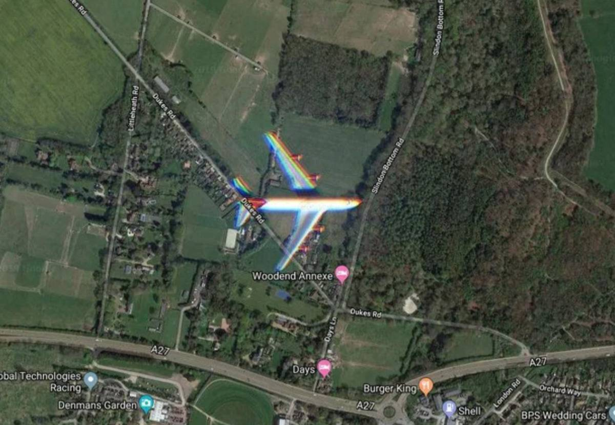 plane caught on satellite passing over town
