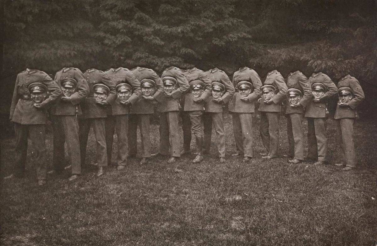 A photography trick makes a line of soldiers appear like they're holding their heads.
