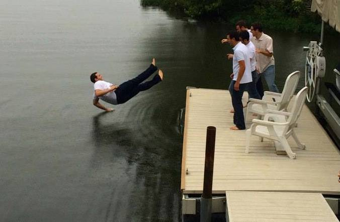 man falling in water