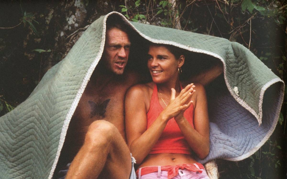 Steve McQueen and Allie MacGraw Taking Cover From The Rain On Set