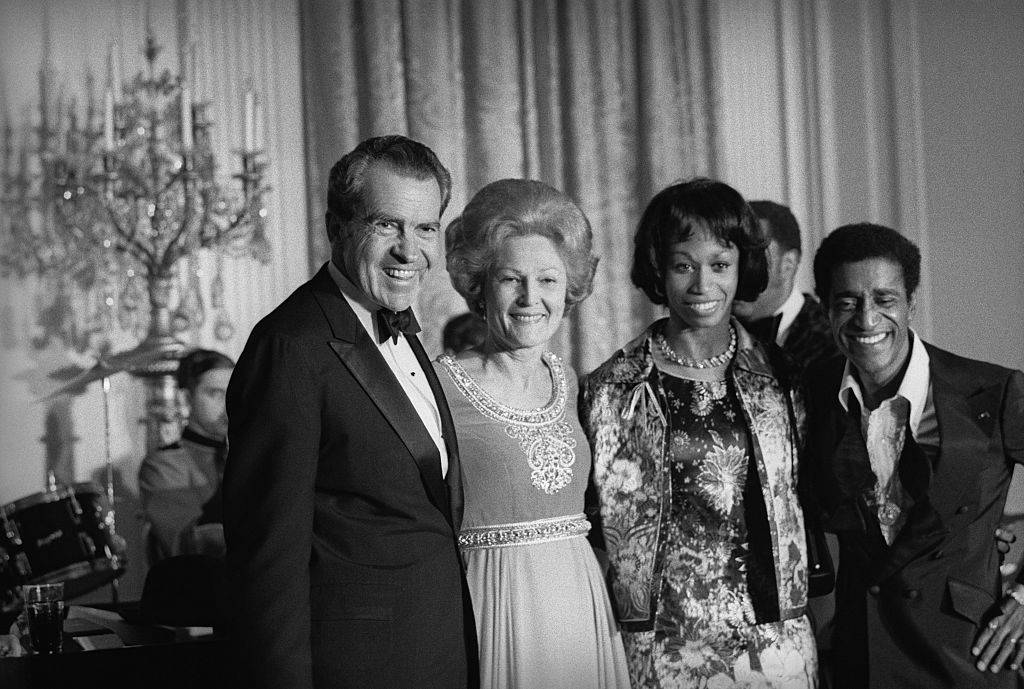 Entertainer Sammy Davis, Jr., (right) acknowledges ovation following his performance at a White House gala.