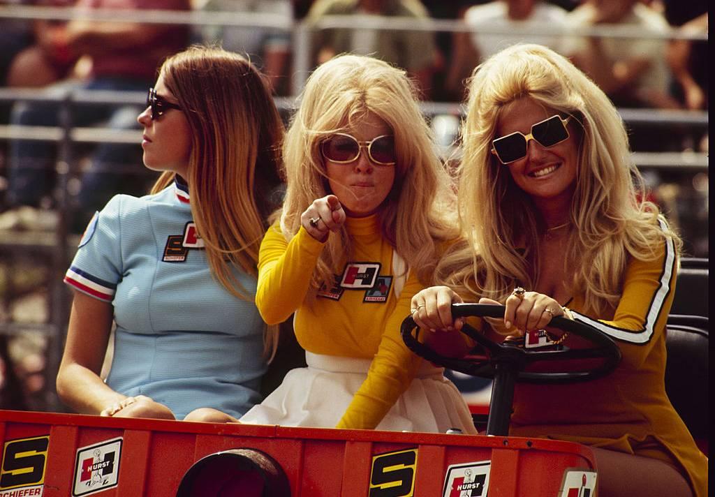 Girls on a golf cart