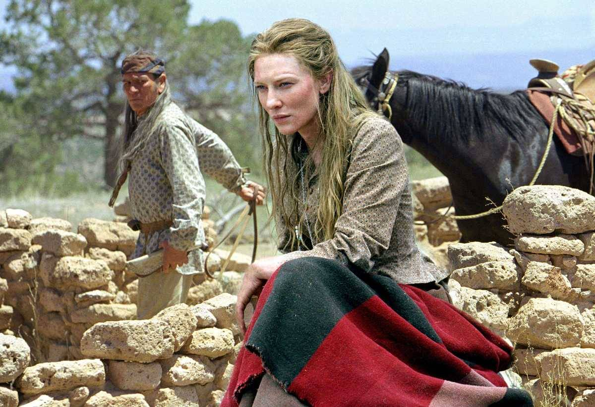 cate blanchett in front of a man with a horse in the missing