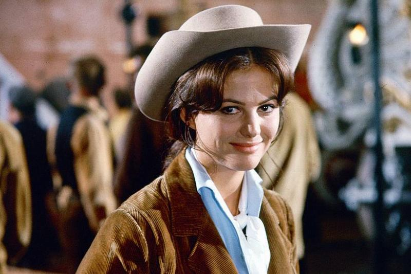 claudia cardinale dressed as a cowgirl in the magnificent showman