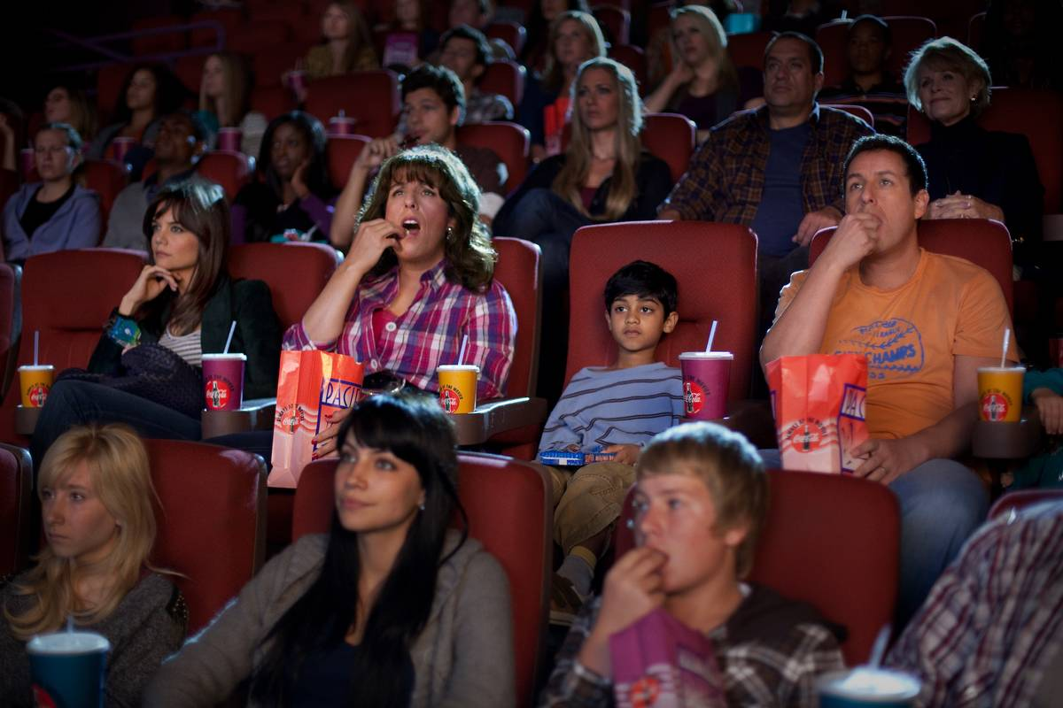 katie holmes and adam sandler in a movie theater in jack and jill