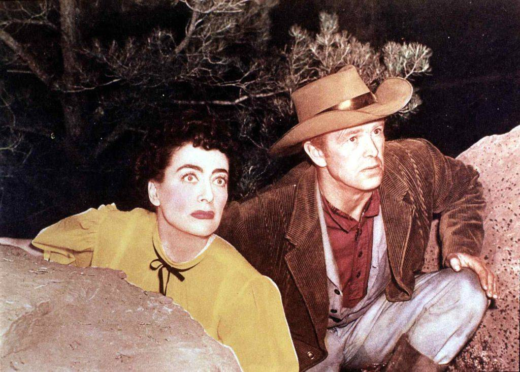 joan crawford with a cowboy in johnny guitar