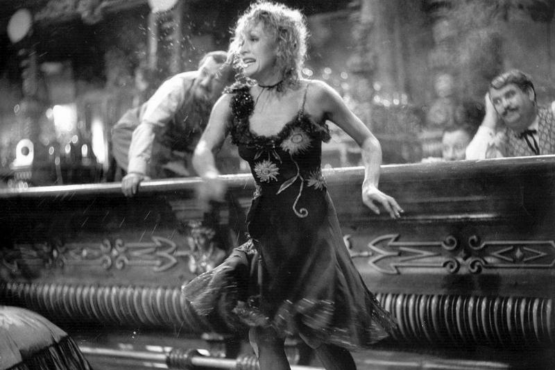 marlene dietrich wearing a dress in a saloon in destry rides again