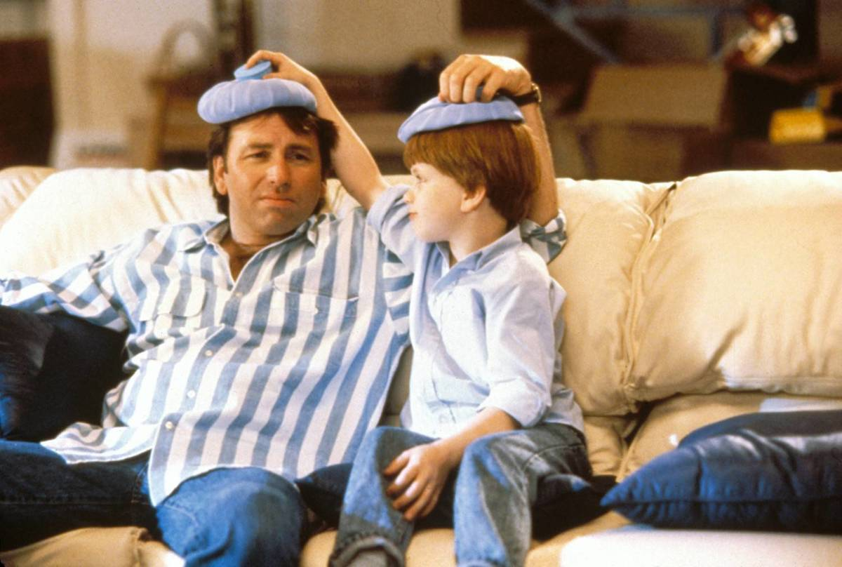 dad and son putting ice packs on each other's heads in problem child