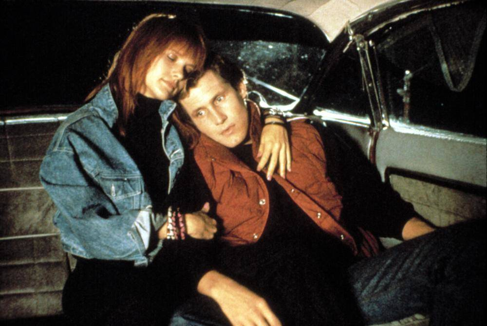 woman and man sitting in a car in return of the living dead part ii