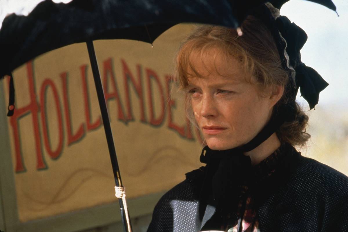suzy amis holding an umbrella in the ballad of little jo