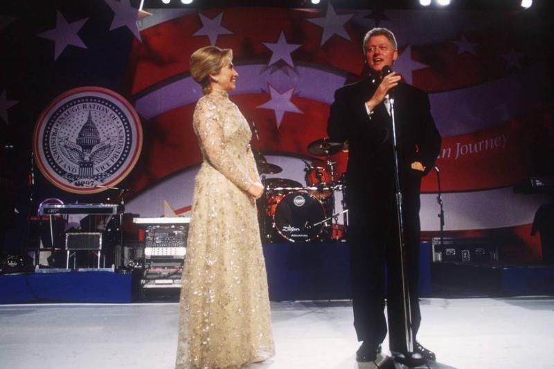President Bill Clinton and wife Hillary stand at an inaugural ball.