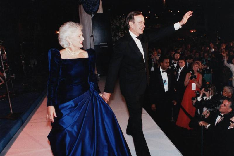 George H.W. and Barbara Bush wave at the crowd of the 1989 inauguration.