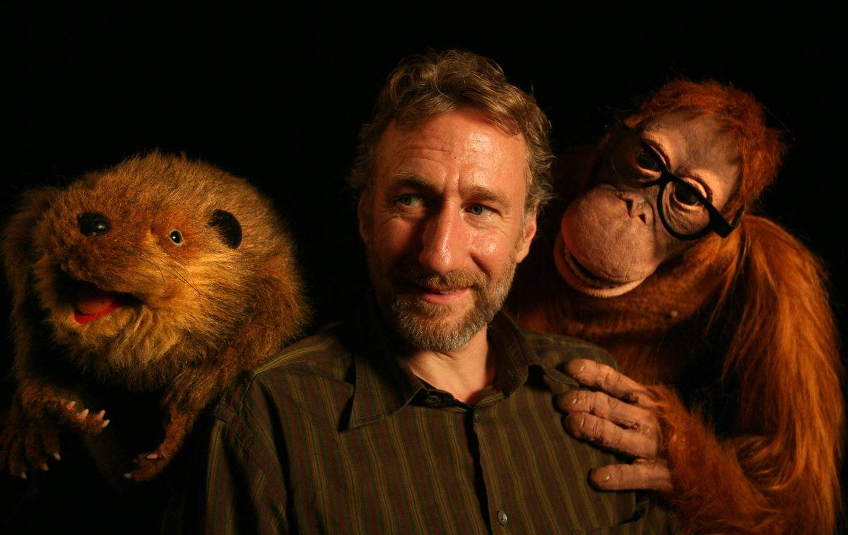 Brian Henson poses with a few of his puppets.