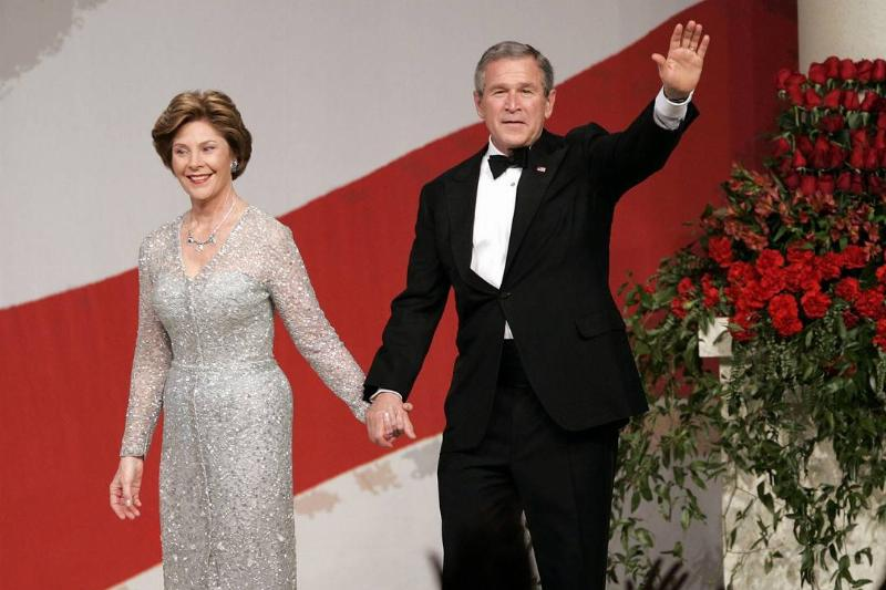 George and Laura Bush wave at the crowd during the 2005 inauguration.