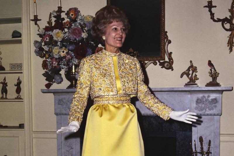 In her apartment, Pat Nixon models the gown that she wore to the Inaugural Ball.