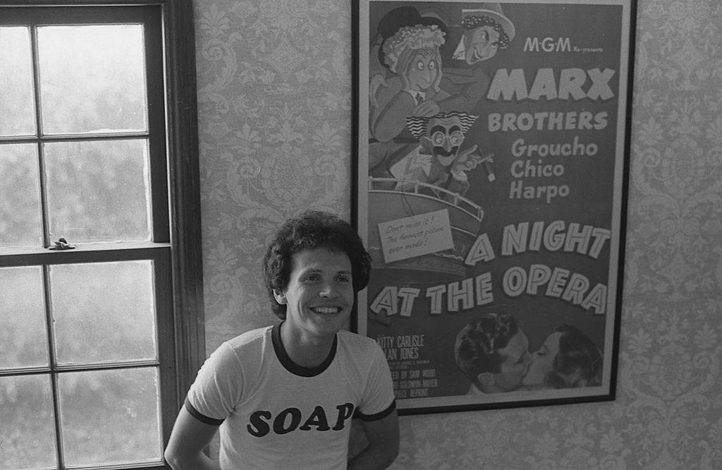 billy crystal wearing a shirt that says soap with a poster of the marx brothers