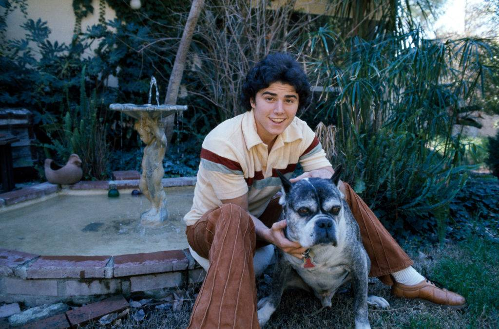 christopher knight posing with his dog outside