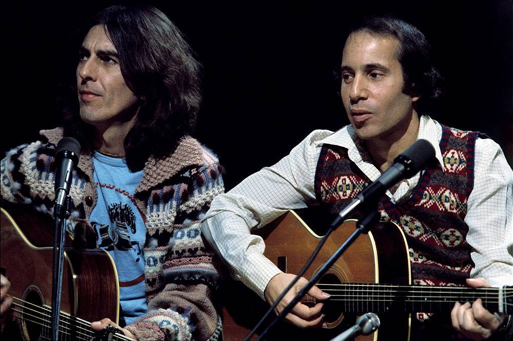 george harrison and paul simon playing guitar