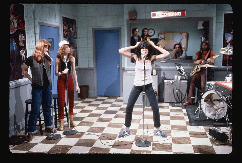 Gilda Radner does a comic impersonation of punk rock singer Patti Smith