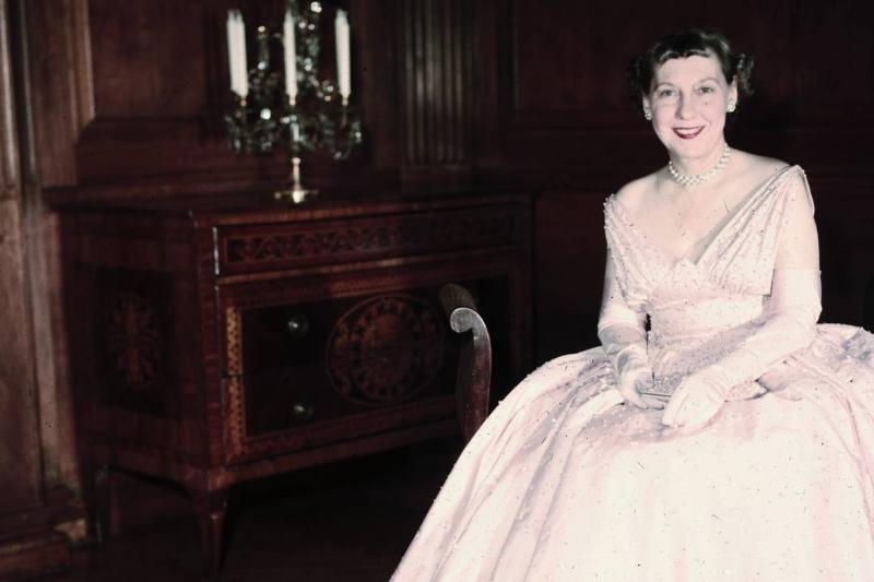Mamie Eisenhowever sits in her white inaugural ball gown.
