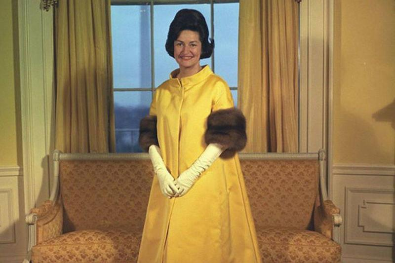 Lady Bird Johnson poses in her inauguration gown.