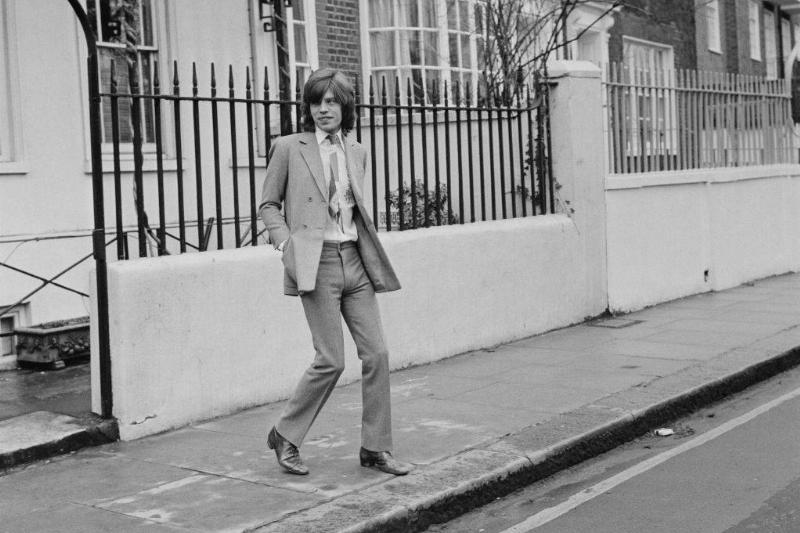 mick jagger walking in the street