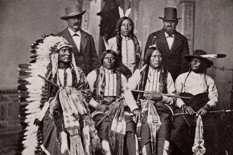 Sioux chiefs pose for a photo with representatives at the White House.