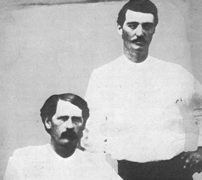 Wyatt Earp and Bat Masterson posing for a picture together