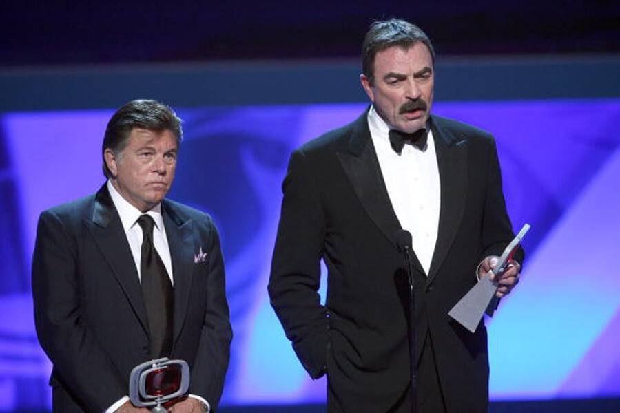 Tom Selleck accepting trophy