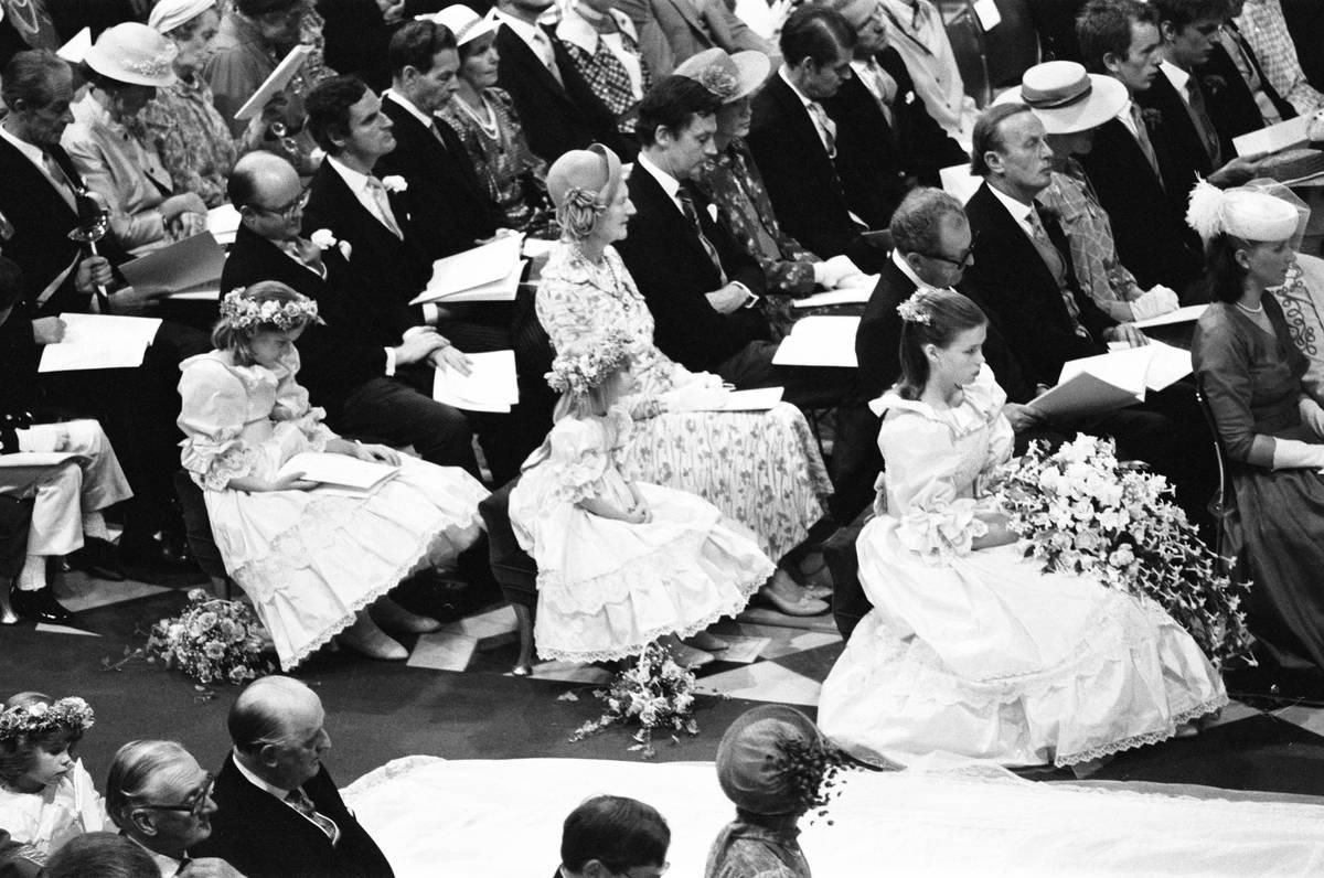 Diana's bridesmaids watch the wedding ceremony.
