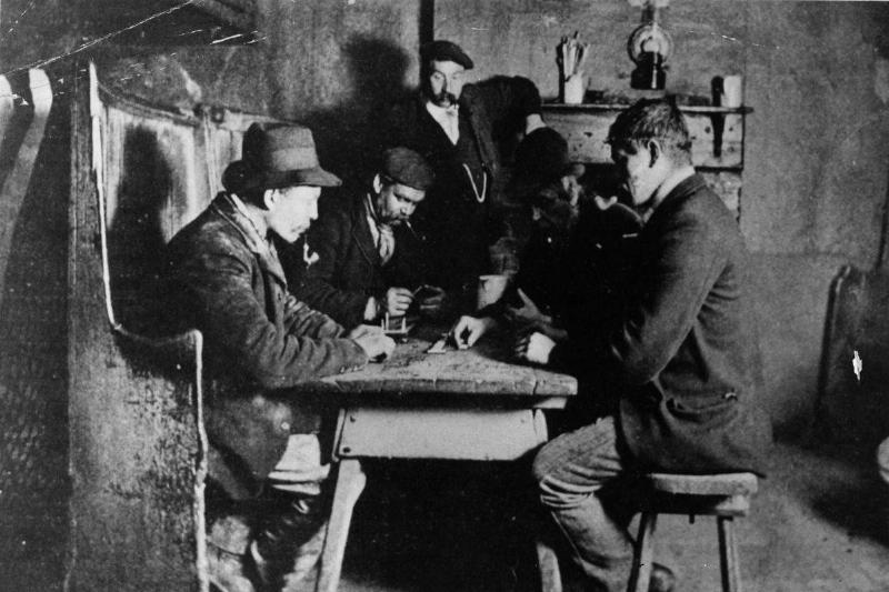 Men play card games in a tavern in 1860.