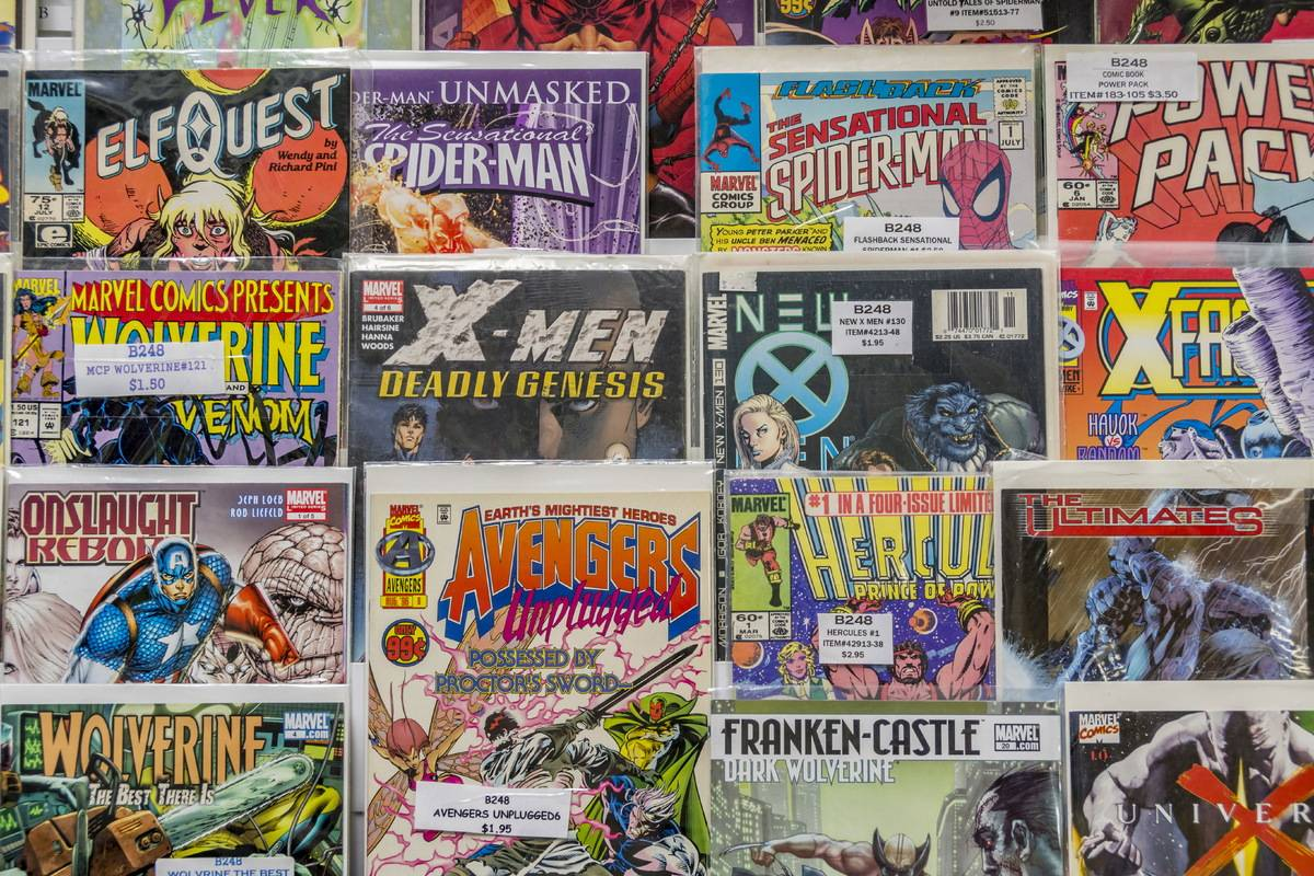 Rack of comic books for sale at a flea market