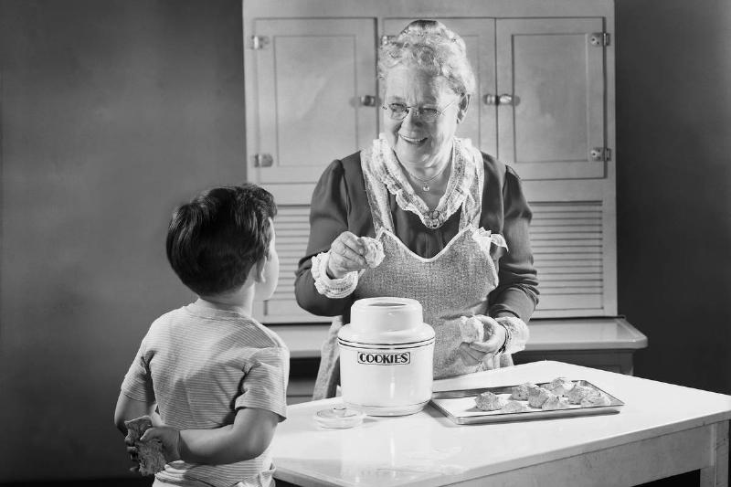 Grandmotherly Woman Making Cookies for a Boy