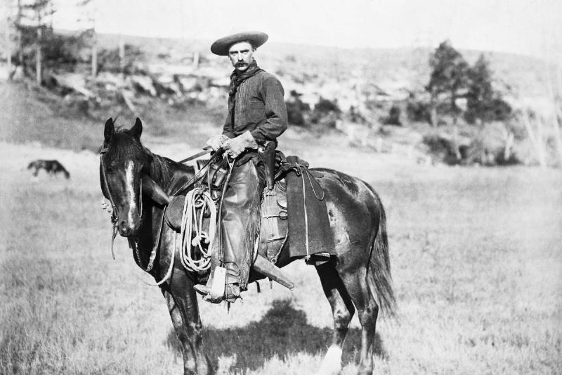 A deputy sits on a horse in the 1800s.