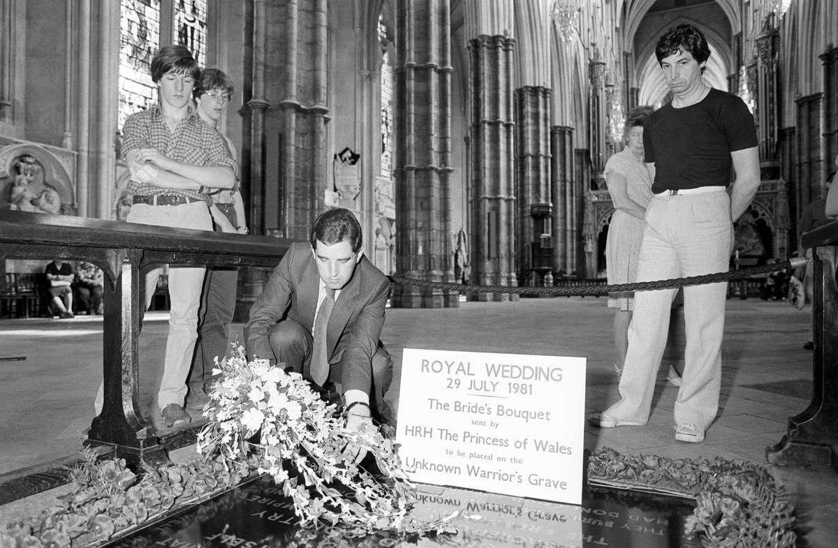 A man places Diana's bridal bouquet at the Tomb of the Unknown Warrior's grave.