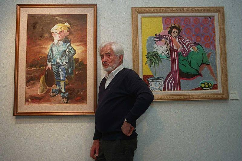 hank ketcham posing with a dennis the menace painting