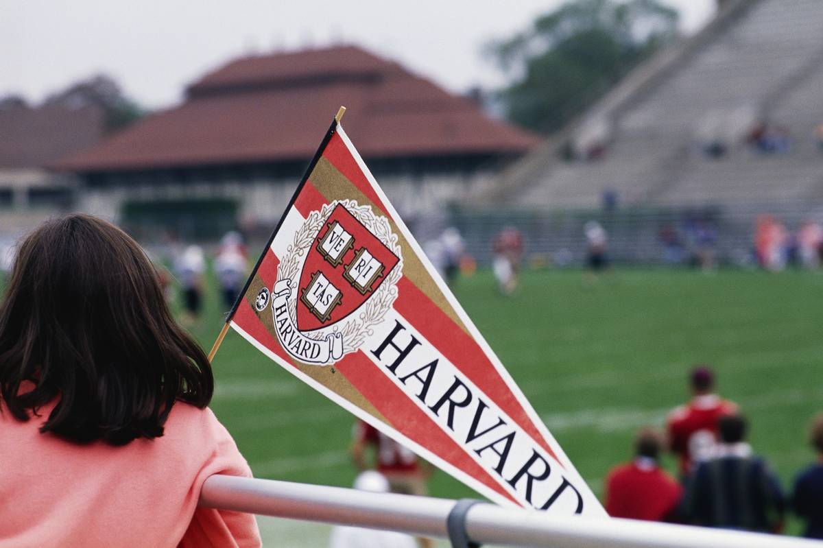 Girl with Harvard Pennant Watching Football Practice