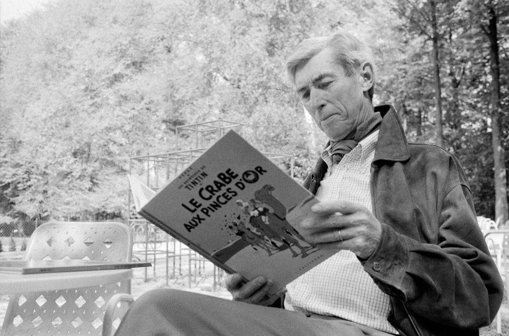 hergé reading a book of his work