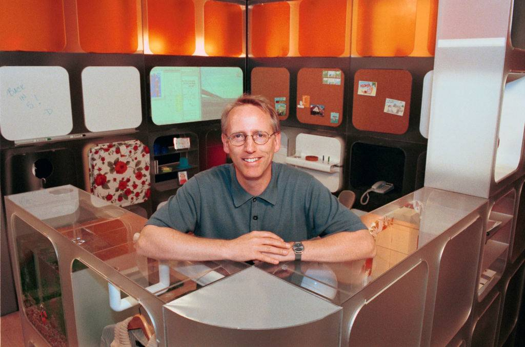 scott adams sitting at a cubicle