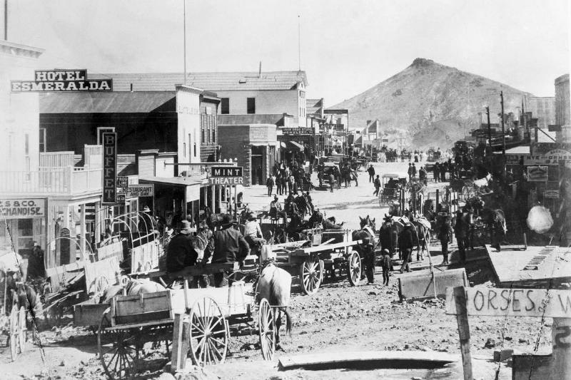 Traffic occurs in a Nevada town in 1927.